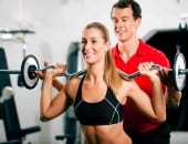Woman with Personal Trainer in gym - lep fitness - sheffield personal trainer - best personal trainer in sheffield - online personal trainer - online fitness coach