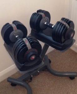 adjustable dumbbells in a home gym - LEP Fitness blog post