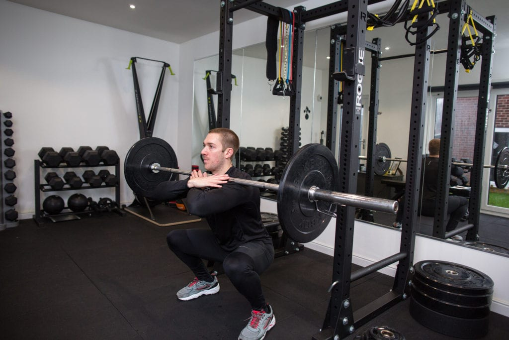LEP Fitness personal trainer and head coach Nick Screeton doing a front squat